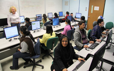adult students sitting at computers