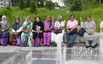 seniors sitting in front of a fountain