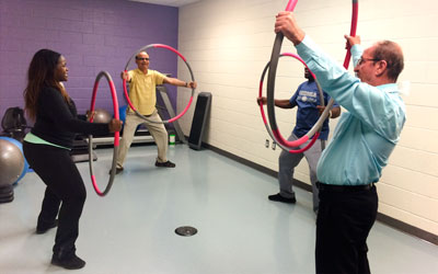 Seniors exercising with hula hops